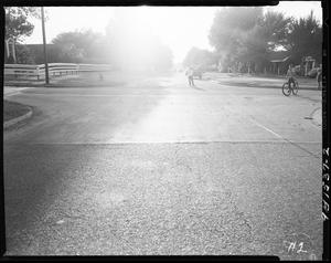 Primary view of object titled 'Children Playing with Roller Skates and Bicycle in Oklahoma City, Oklahoma'.
