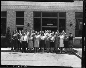 Primary view of object titled 'Group of Men and Women in front of Southwest Wheel Company in Oklahoma City, Oklahoma'.