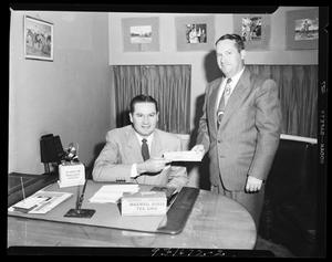 Primary view of object titled 'Two Men with General Food Sales Company in Oklahoma City, Oklahoma'.