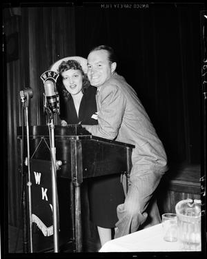 Primary view of object titled 'Bob Hope and UNIDENTIFIED Woman at WKY Microphone at the Bob Hope Show in Oklahoma City, Oklahoma'.