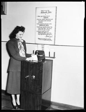 Primary view of object titled 'Woman at an IBM Automatic Teller Machine in Oklahoma City, Oklahoma'.