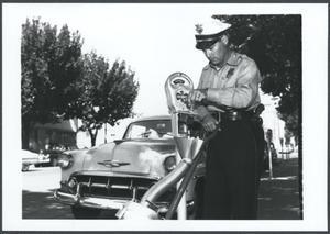 Primary view of Oklahoma City Police Officer at a Parking Meter in Oklahoma City, Oklahoma