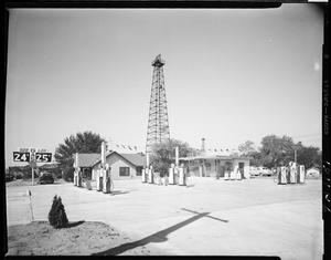 Primary view of object titled 'Rob-Lon Gas Station and Oil Well Drilling Derrick in Oklahoma City, Oklahoma'.