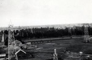 Primary view of object titled 'Four aerial views and one ground view of Oklahoma City.'.