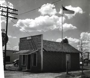 Primary view of object titled 'Post Office building in Lone Grove.'.