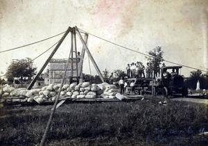 Primary view of object titled 'Two different views of the Dyer Brothers Transfer workers as they haul the 12 tons of stone used to construct the Apple family mausoleum in Hillcrest cemetery in Ardmore.'.