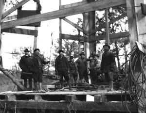 Primary view of object titled 'A crew of oil workers at a drilling site.'.