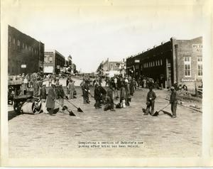 Primary view of object titled 'Laborers Completing a Section of Street in Guthrie'.