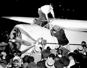 Primary view of object titled 'Wiley Post on top of airplane.'.