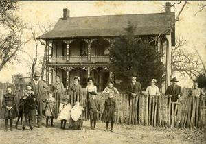 Primary view of object titled 'Unknown family in front of house.'.