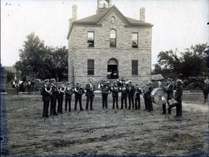 Primary view of object titled 'Band in front of unknown building.'.