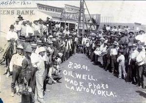 Primary view of object titled 'Crowd in Front of Oil Well and Bank in Lawton'.
