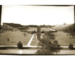 Primary view of object titled 'Reflecting Pool and Football Stadium at the University of Oklahoma in Norman, Oklahoma'.
