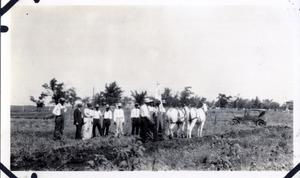Primary view of object titled 'Group of Men in a Field'.