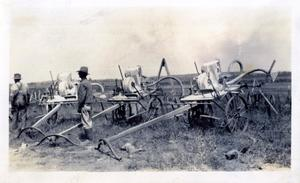 Primary view of object titled 'Men in Field With Equipment'.