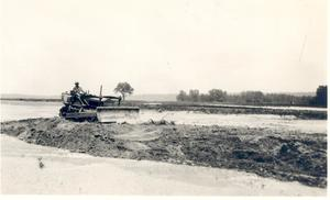 Primary view of object titled 'Bulldozer Operating on Flooded Farm'.