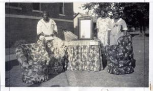 Primary view of object titled 'African-American Women Work With Upholstery Fabrics'.