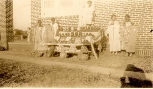 Primary view of object titled 'African American Women Exhibiting Produce'.