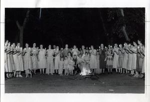 Primary view of object titled 'Group of Women Around Bonfire'.