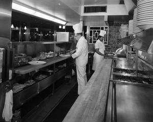 Primary view of object titled 'Chefs Cooking at Beverly's Grill'.