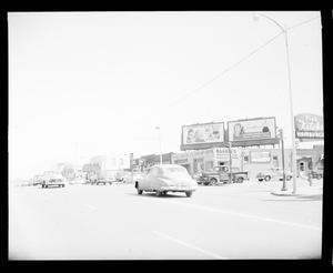 Primary view of object titled 'View of Northeast 23rd Street including the Bison Theatre'.