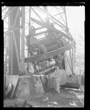 Primary view of object titled 'Wrecked Oil Well Machinery'.