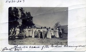 Primary view of object titled 'Ladies Cleaning Park in Waukomis, Oklahoma'.