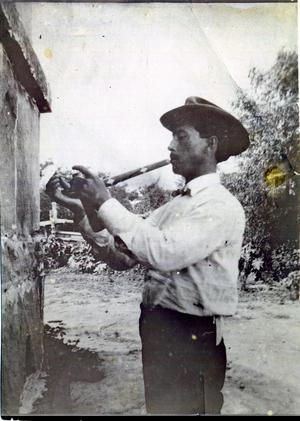 "Primary view of object titled 'Alexander Posey Lighting the ""Pipe of Peace""'."