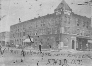 Primary view of object titled 'First National Bank and Frantz Hotel, Enid, O.T.'.